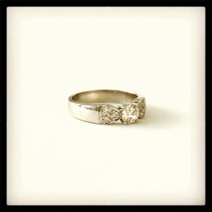 Diamond-Engagement-Ring-with-Bow-Detail-Platinum